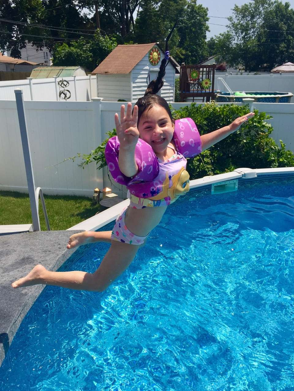 Gia Sanders, 4 jumps into her cousin's pool