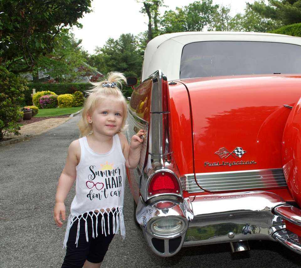 Julie Schoell, 2 years old. Admiring a classic
