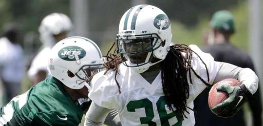 New York Jets' Doug Middleton, right, runs with