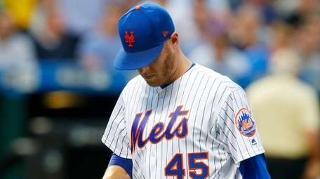 Zack Wheelerof theMets is removed in the second