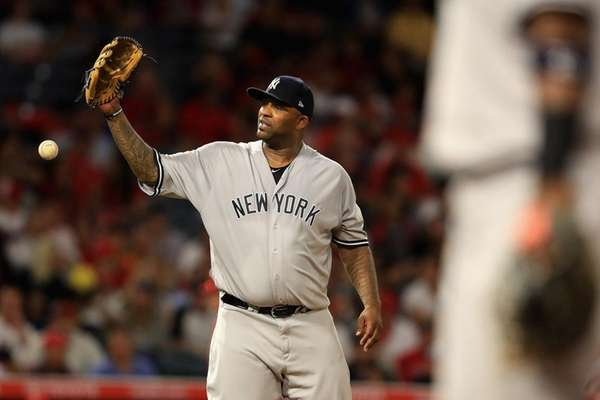 CC Sabathia drops a return throw in