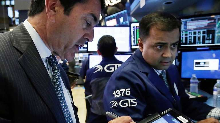 Trader Mark Muller, left, and specialist Dilip Patel