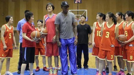 Former NBA basketball star Dennis Rodman, center right,