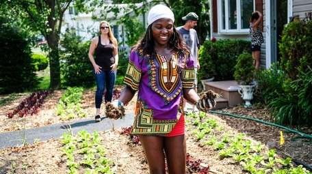 Rosette Basiima Adams of Lawn Island Farms cultivates