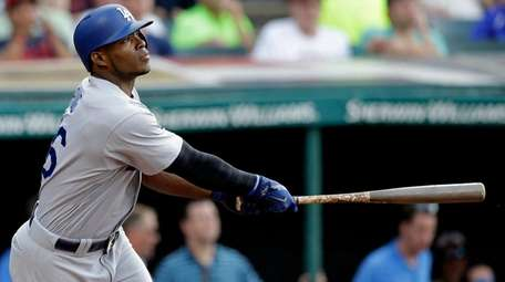 Los Angeles Dodgers' Yasiel Puig watches his two-run