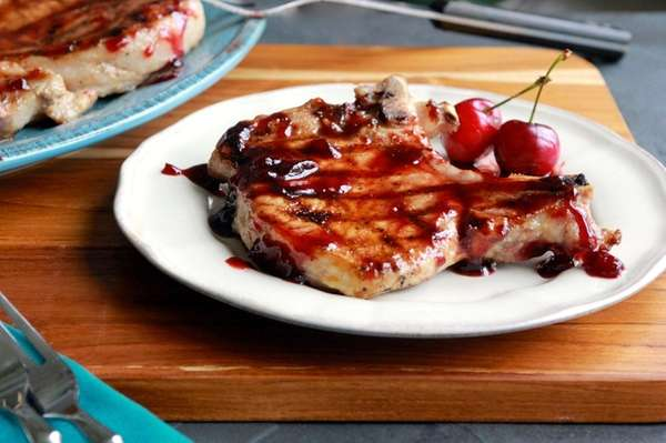 Grilled pork chops with cherry-sriracha sauce.