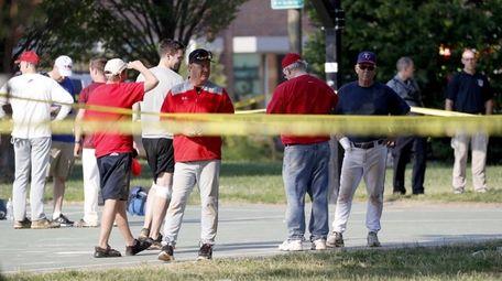People gather near the shooting scene in Alexandria,