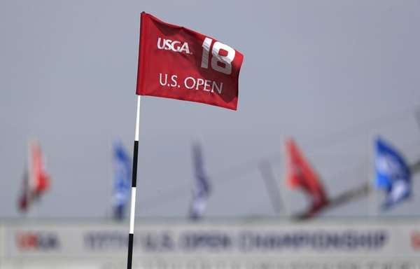 The pin flag on the eighteenth hole during