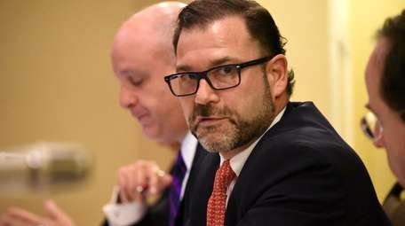 NIFA Chairman Adam Barsky and other board members