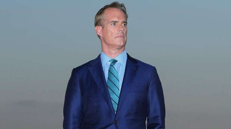 Joe Buck looks on after the final round