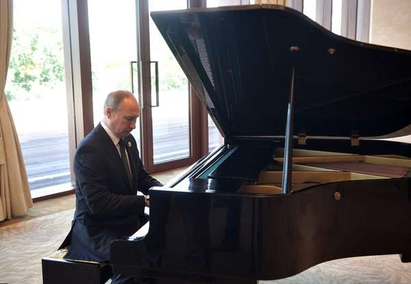 Russian President Vladimir Putin plays piano in Beijing