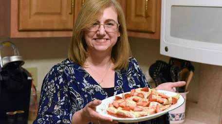 Julia Mullen prepares Polish nalesnikis at her Centerport