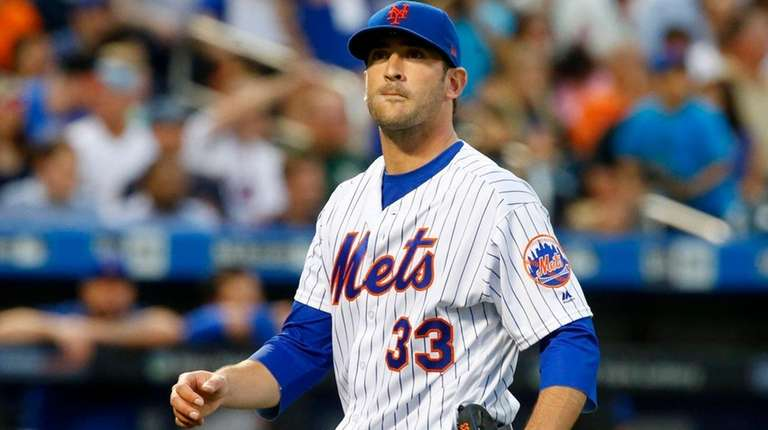 Matt Harvey of the Mets walks to the