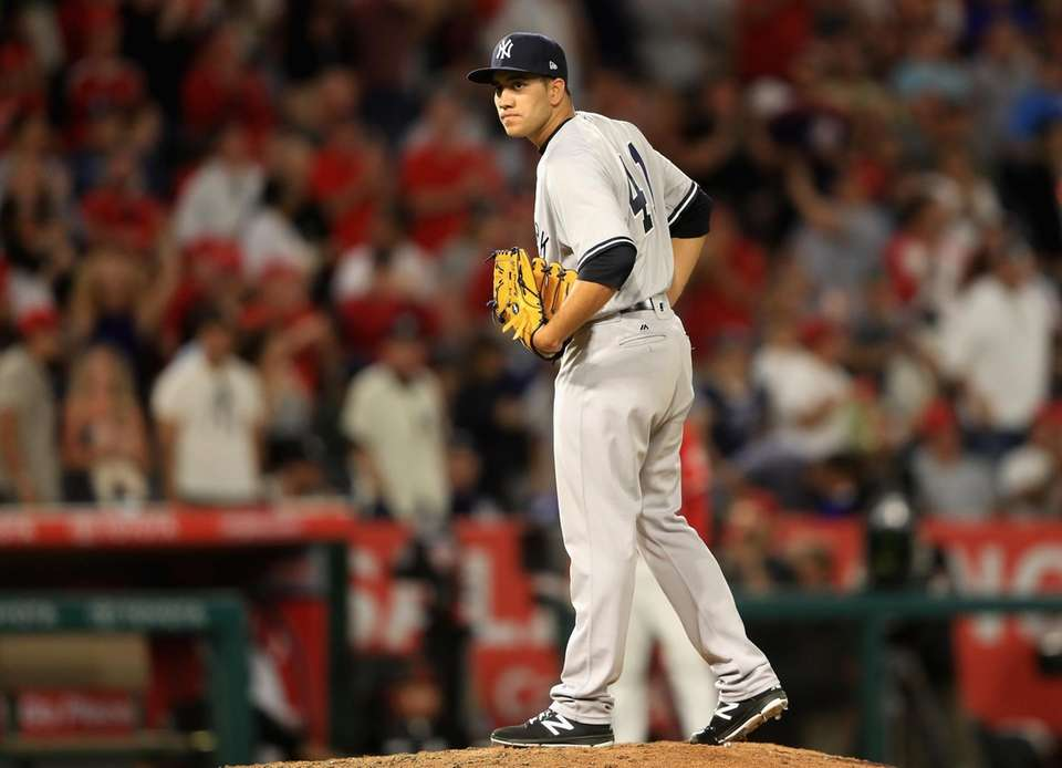CC Sabathia of the Yankees looks to first
