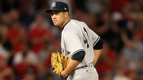 Ronald Herrera of the Yankees looks to first