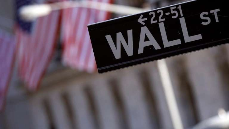 A Wall Street street sign near the New