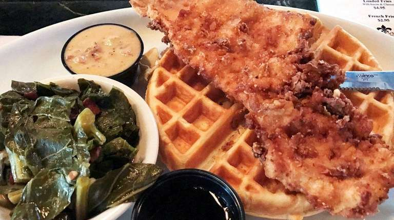 Flattened fried chicken breast and waffles at Storyville