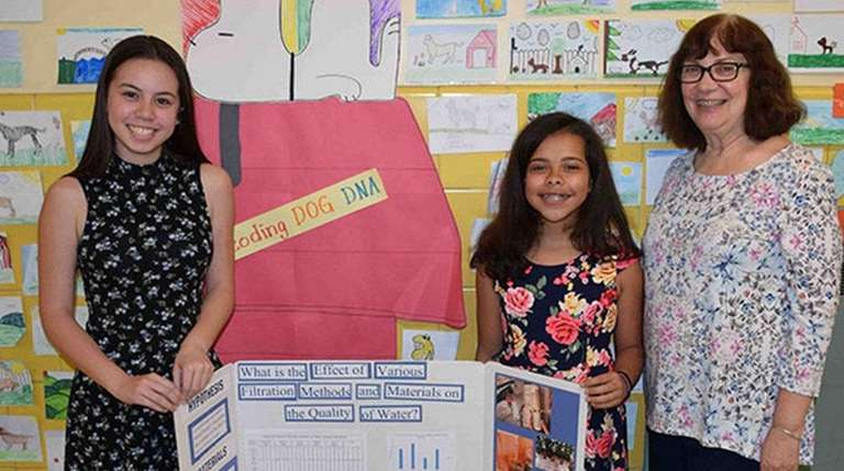 Eighth-graders Emma Jones, left, and Elianna Rivera with