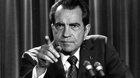 President Richard Nixon, during the Watergate investigation, tells