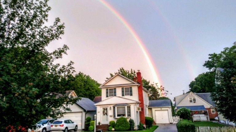 A rainbow frames the shot of Joyce Sullivan's