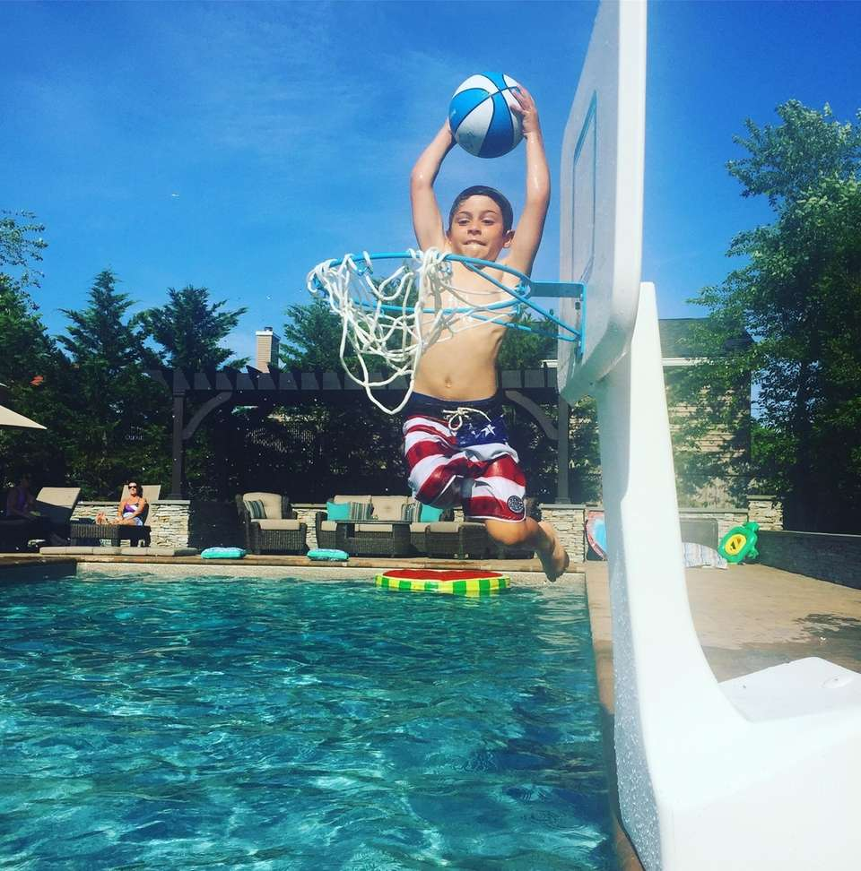 Cooper practicing his dunking skills in the pool.