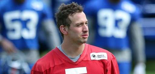 Giants rookie quarterback DavisWebb leaves the field after