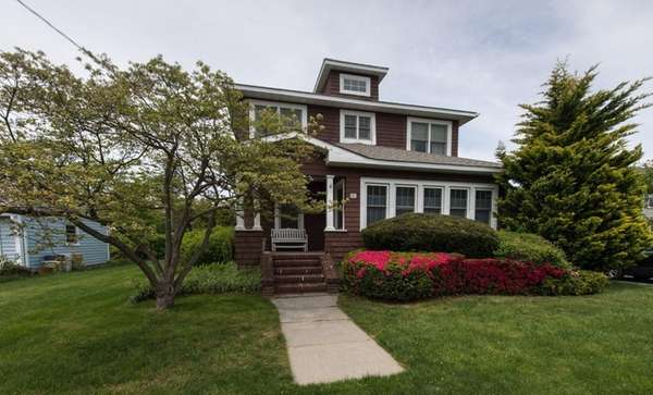This six-bedroom, 2½-bath home in West Islip is