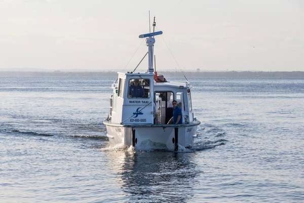 A water taxi arrives at Fire Island's Ocean