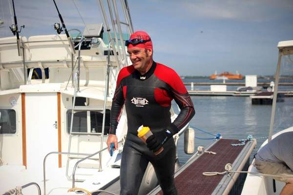 Activist Christopher Swain, 49, completed a 133-mile swim