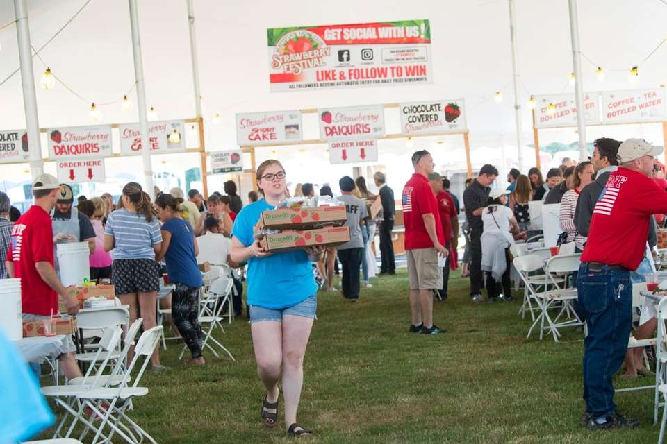 Hulling strawberries at the 63rd annual Mattituck Lions