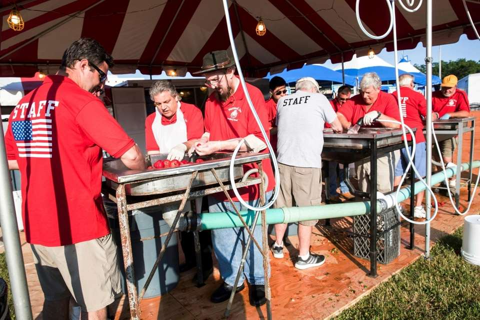 Lions Club members wash strawberries at the 63rd