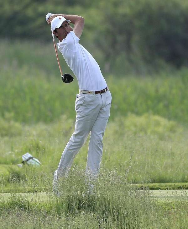 Stewart Hagestad hits a tee shot during the