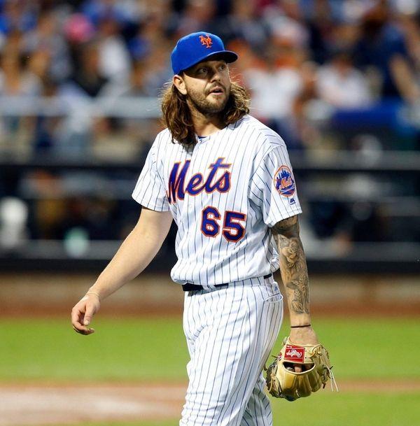 Robert Gsellman of the Mets walks to the