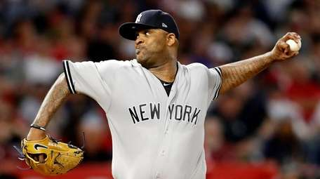 Yankees pitcher CC Sabathia delivers against the Angels