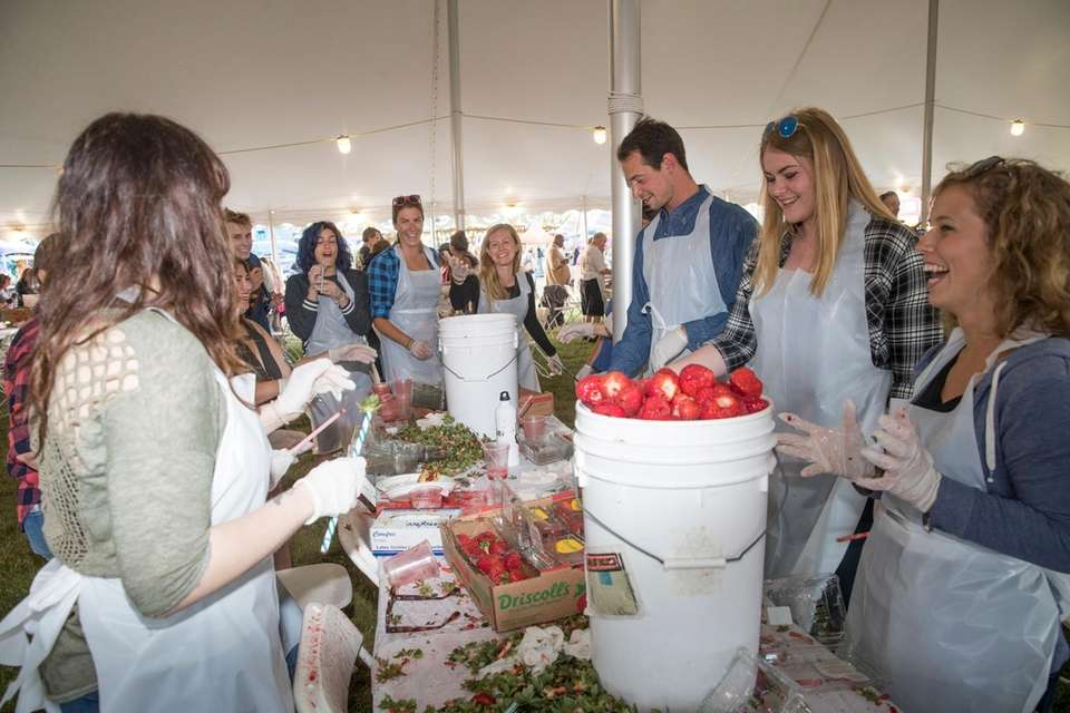 Friends gather to hull strawberries at the Mattituck