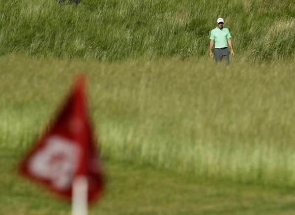 Rory Mcilroymakes his way to the 12th hole