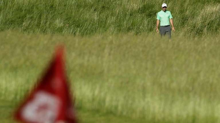 Rory Mcilroy makes his way to the 12th hole