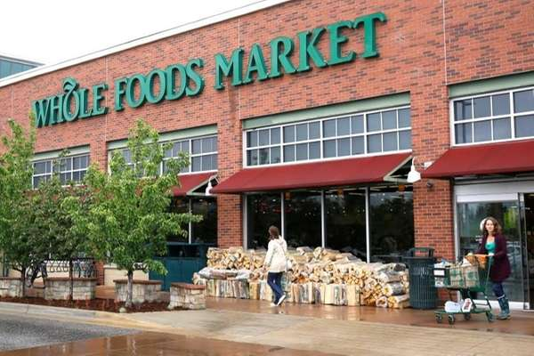 Customers leave the Whole Foods Market in Boulder,