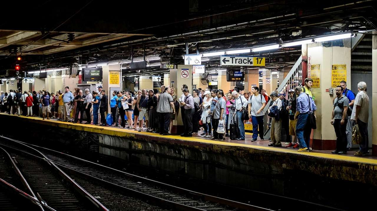 Commuters wait for LIRR trains during rush hour