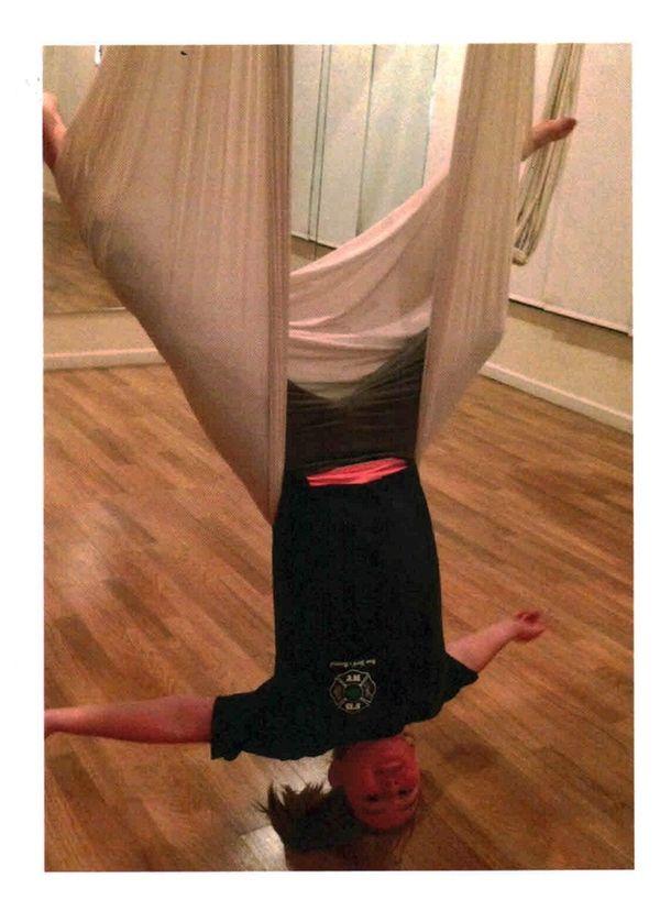 Kidsday reporter Vincenza Julian does antigravity yoga.