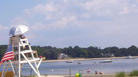 Lifeguards watch the bay at Centre Island Beach.