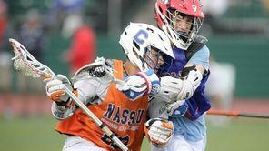 Nassau Rising Juniors Nick Turrini (68) carries the