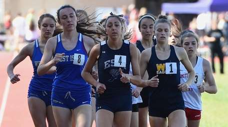 Runners compete in the Division Two 1500 Meter