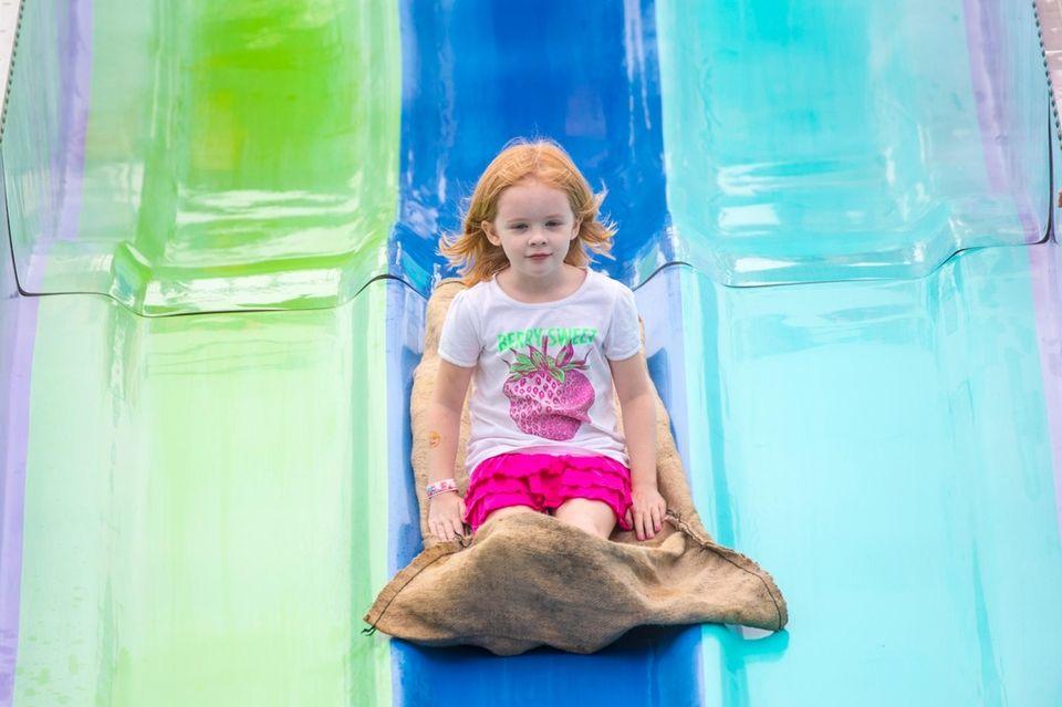 Amber Kollmann, 6, from North Babylon, travels down