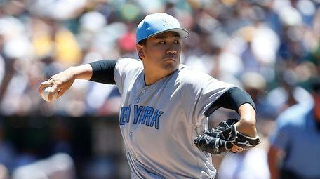 New York Yankees pitcher Masahiro Tanaka throws against