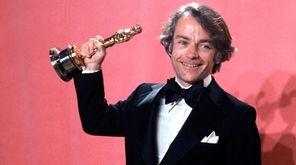 John G. Avildsen shows off the Oscar he
