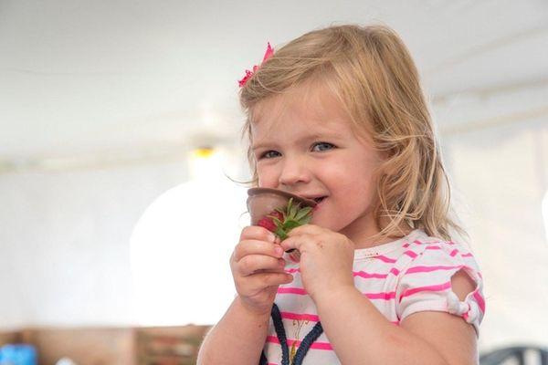 Victoria Scholtz, 2, from Mattituck takes a bite