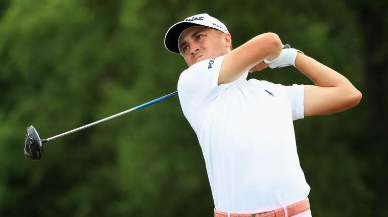 Justin Thomas of the United States plays his