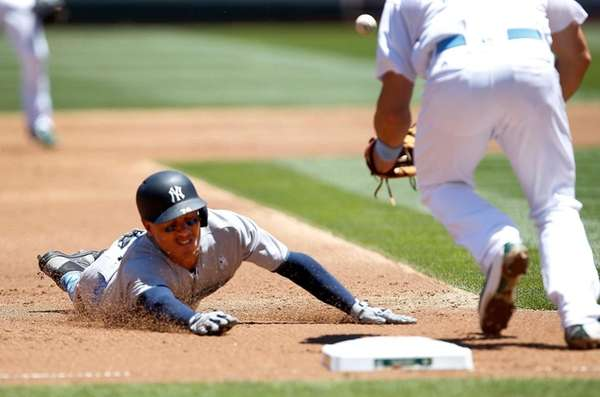 New York Yankees' Ronald Torreyes, left, slides into