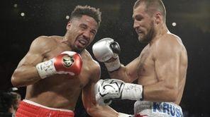 Andre Ward, left, fights Sergey Kovalev during a